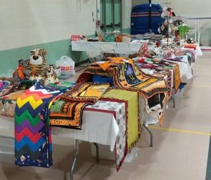 Boutique table with handmade items for sale at the quilt show